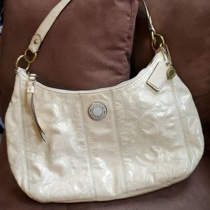 Cream leather Coach signature bag